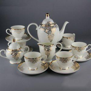 Bộ ấm trà sứ xương hoa văn vàng