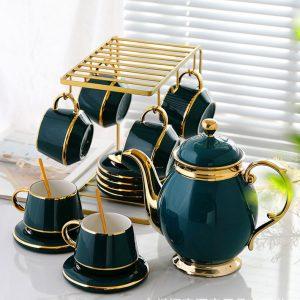 Bộ ấm trà sứ xanh khung treo cốc vàng
